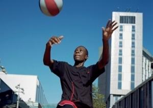 Boy playing football in London