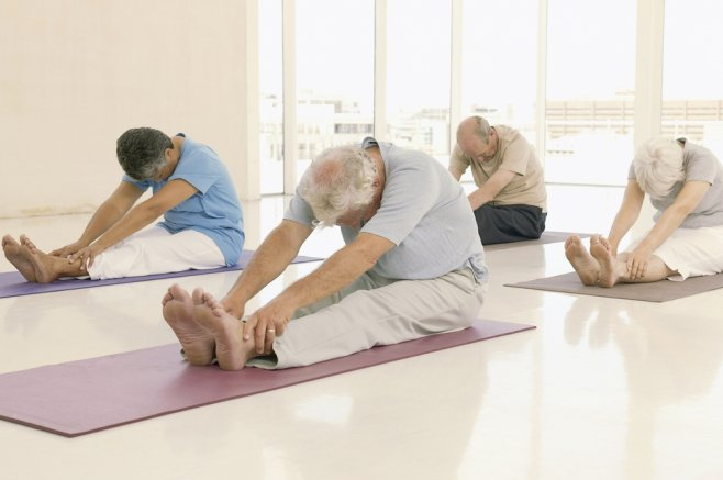 Old people at a yoga class